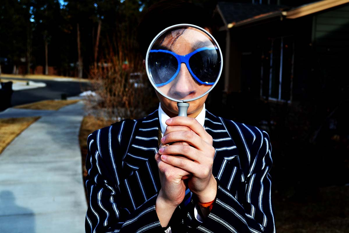 Find a job photo for national resources woman with a magnifying glass